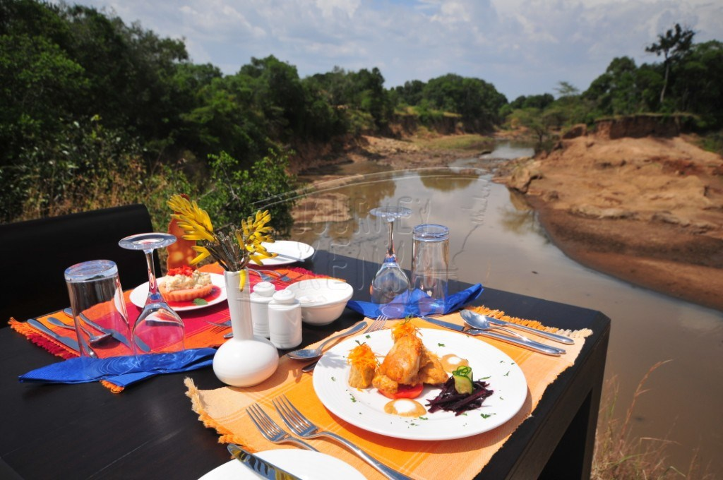 A lunch meal set beside a river at Ngerende Island Lodge