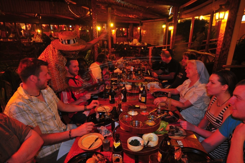 Diners enjoying a meal at the Carnivore Restaurant in Nairobi