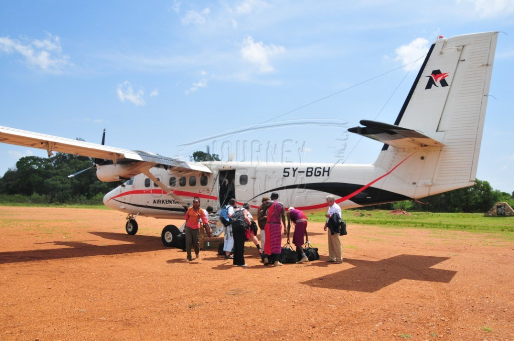 Passengers disembark at an airstrip in Maasai Mara