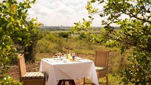 Bush dining at Ole Sereni, with stunning view of Nairobi National Park and the city's skyscrapers. Photo Credit: Ole Sereni Hotel