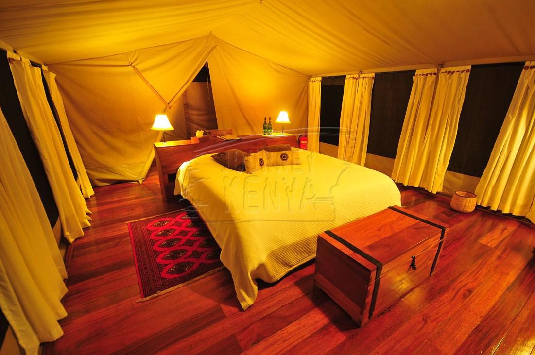 An elegant luxury tent at Karen Blixen Camp, in Mara North Conservancy.
